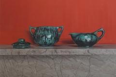 Schouw met aardewerken potjes
